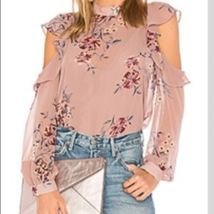 Beautiful flowy blouse with shoulder cut outs